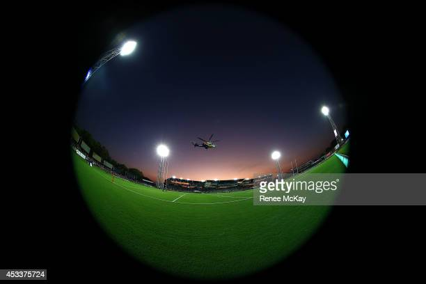 Ex Eels player Nathan Cayless delivers the match ball in a rescue helicopter during the round 22 NRL match between the Parramatta Eels and the...
