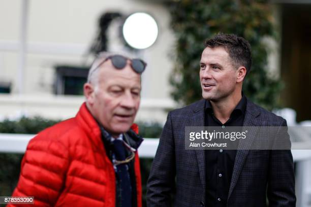 Ex England footballer Michael Owen chats with jockey coach Colin Brown prior to riding in a charity race at Ascot racecourse on November 24 2017 in...