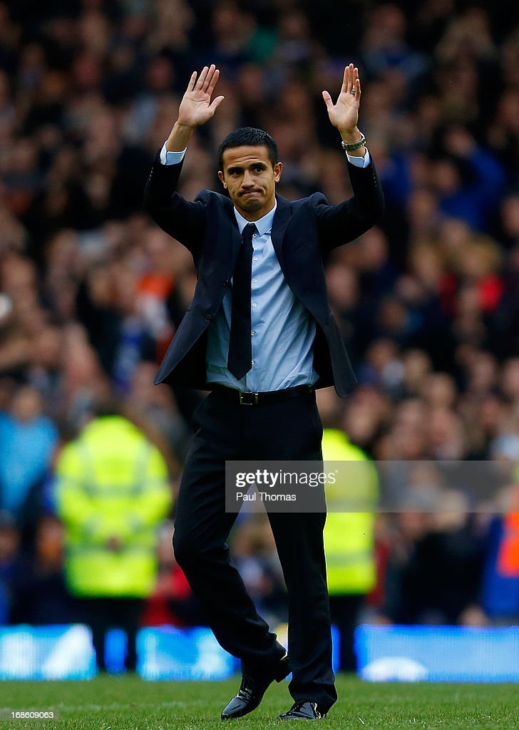 Ex Everton player Tim Cahill waves to the home fans after the Barclays Premier League match between Everton and West Ham United at Goodison Park on May 12, 2013 in Liverpool, England.