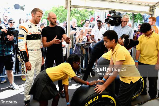 Ex F1 World Champion Jenson Button of Great Britain and McLaren Honda at the Pirelli Pit Stop Challenge stand during F1 Live London at Trafalgar...