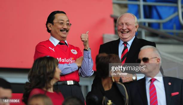 Ex Labour leader Neil Kinnock shares a joke with Cardiff owner Vincent Tan before the Barclays Premier League match between Cardiff City and...