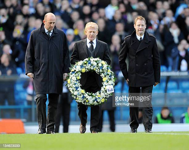 Ex Leeds United players Gary McAllister Gordon Strachan and David Batty lay a wreath prior to kick off during the npower Championship match between...