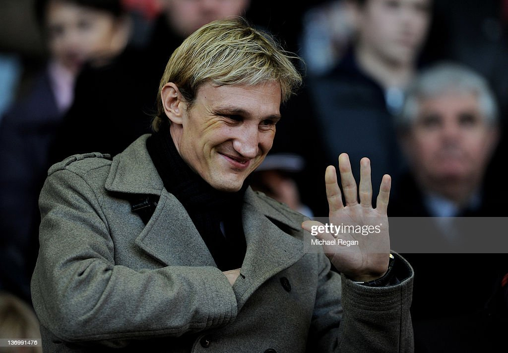 Ex Liverpool player Sami Hyypia waves to the crowd prior to the Barclays Premier League match between Liverpool and Stoke City at Anfield on January...