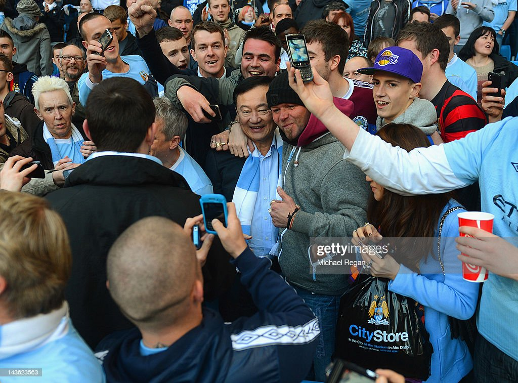 Ex Manchester City owner <a gi-track='captionPersonalityLinkClicked' href=/galleries/search?phrase=Thaksin+Shinawatra&family=editorial&specificpeople=220948 ng-click='$event.stopPropagation()'>Thaksin Shinawatra</a> has his picture taken by fans prior to the Barclays Premier League match between Manchester City and Manchester United at Etihad Stadium on April 30, 2012 in Manchester, England.