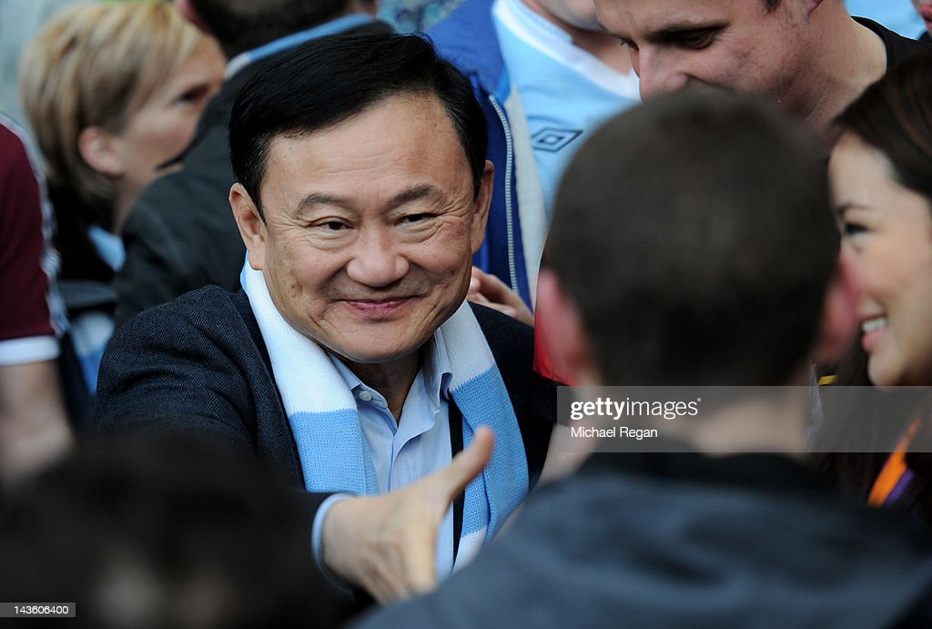 Ex Manchester City owner <a gi-track='captionPersonalityLinkClicked' href=/galleries/search?phrase=Thaksin+Shinawatra&family=editorial&specificpeople=220948 ng-click='$event.stopPropagation()'>Thaksin Shinawatra</a> shakes hands with fans prior to the Barclays Premier League match between Manchester City and Manchester United at the Etihad Stadium on April 30, 2012 in Manchester, England.