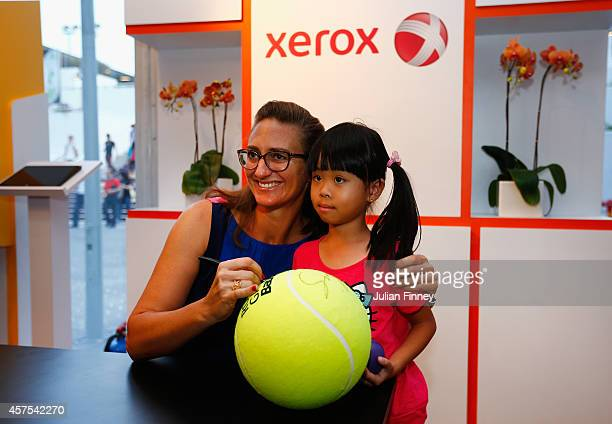 Ex player Mary Pierce visits the Xerox fans booth during day one of the BNP Paribas WTA Finals tennis at the Singapore Sports Hub on October 20 2014...