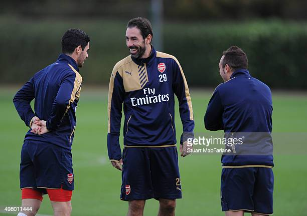 ex player Robert Pires with Arsenal's Mikel Arteta and Santi Cazorla of Arsenal during a training session at London Colney on November 20 2015 in St...