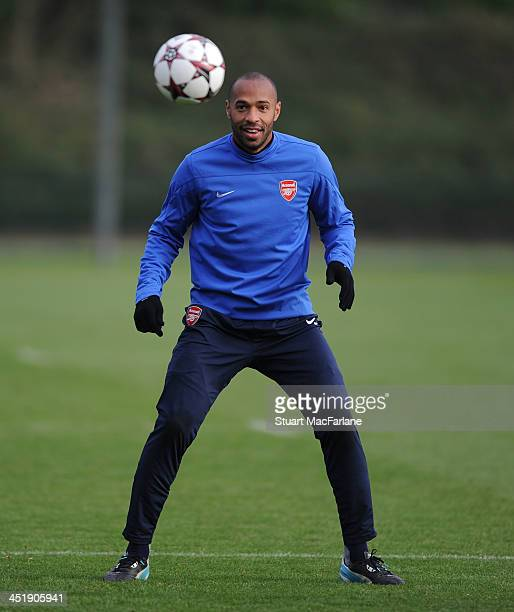 Ex player Thierry Henry trains with the Arsenal squad at London Colney on November 25 2013 in St Albans England