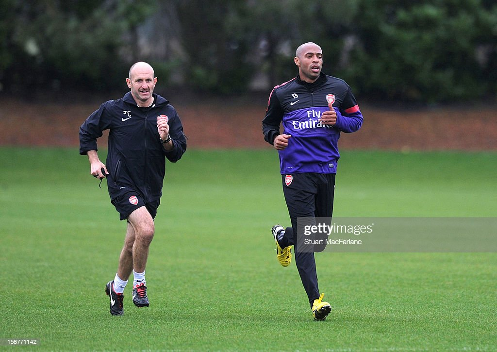 Ex player <a gi-track='captionPersonalityLinkClicked' href=/galleries/search?phrase=Thierry+Henry&family=editorial&specificpeople=167275 ng-click='$event.stopPropagation()'>Thierry Henry</a> with Arsenal fitness coach Tony Colbert during a training session at London Colney on December 28, 2012 in St Albans, England.