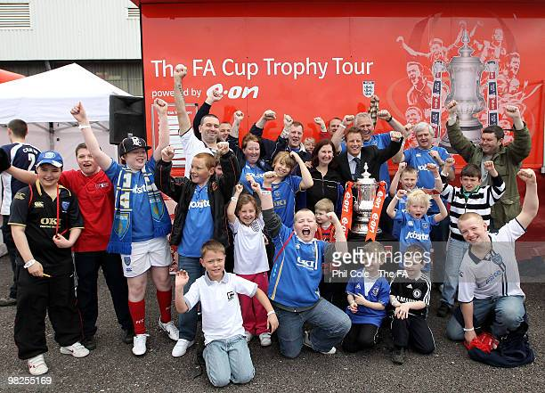 Ex Portsmouth player Paul Walsh celabrates with Fansl during the FA Cup Trophy Tour at Fratton Park on April 5 2010 in Portsmouth England