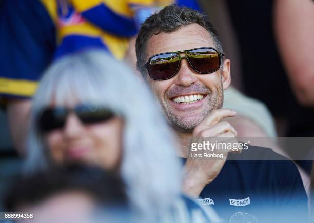 Ex race driver Tom Kristensen cheer during the Danish NordicBet LIGA 1 division match between Hobro IK and FC Vendsyssel at DS Arena on May 27 2017...