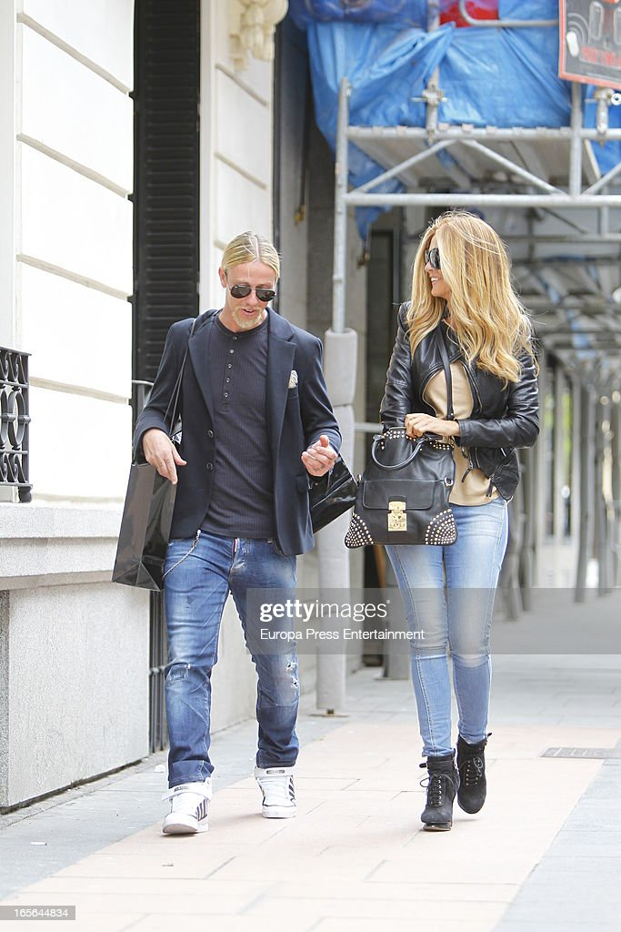 Ex Real Madrid football player Guti and <a gi-track='captionPersonalityLinkClicked' href=/galleries/search?phrase=Romina+Belluscio&family=editorial&specificpeople=7312719 ng-click='$event.stopPropagation()'>Romina Belluscio</a> are seen going for shopping on April 4, 2013 in Madrid, Spain.