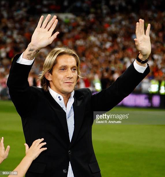 Ex Real Madrid player Michel Salgado waves goodbye to his fans before the Santiago Bernabeu Trophy match at Estadio Santiago Bernabeu stadium on...