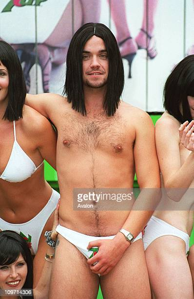 Ex Take That Member Robbie Williams Takes On A New Role In The Soft Drink Poster Ad For 7Up Light With Shaved Legs Robbie Donnes A Black Wig Bikini...
