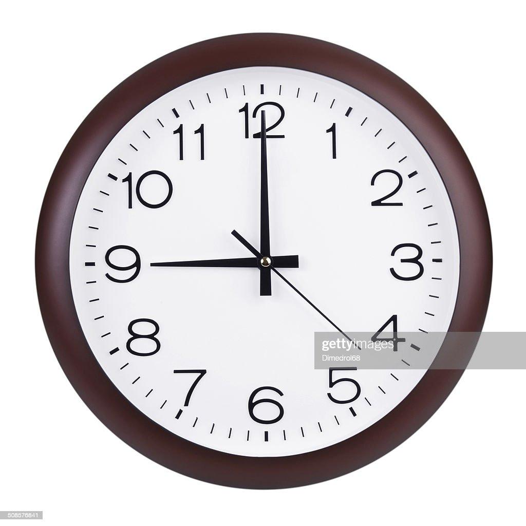 Exactly nine hours on the clocks : Stock Photo