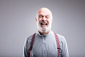 teatrical exaggerated expression of an old man crying