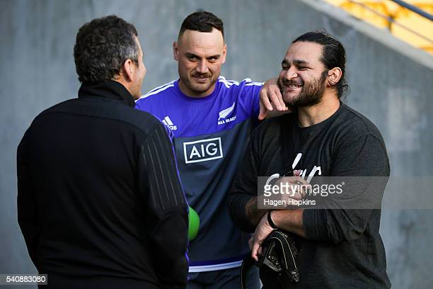 ExAll Black Piri Weepu is distracted by Israel Dagg while talking to assistant coach Wayne Smith during a New Zealand All Blacks Captain's Run at...