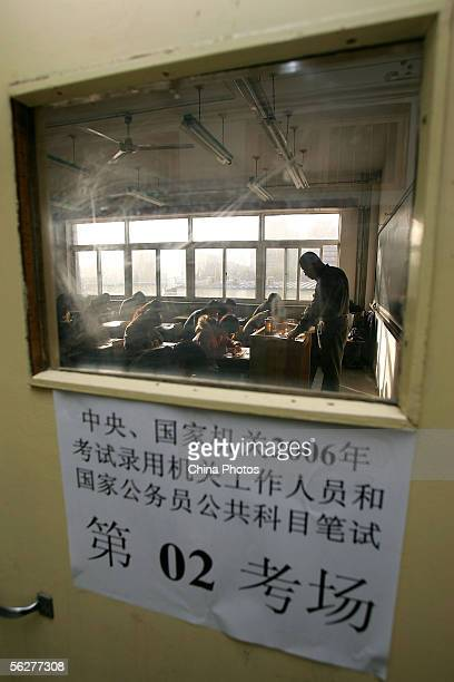 Examinees sit for the national civil servant qualification exam November 26 2005 in Beijing China Some 365000 people around China attended the...
