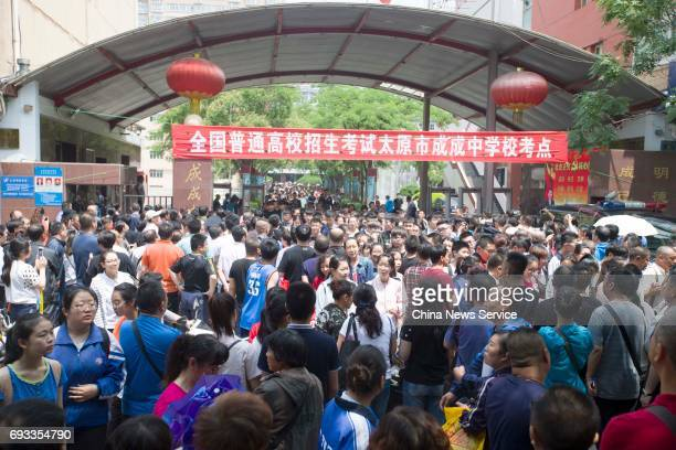 Examinees walk out of the exam site after tested on Chinese literature during day one of China's college entrance examination on June 7 2017 in...