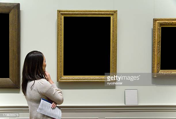 examining pieces of art at a museum