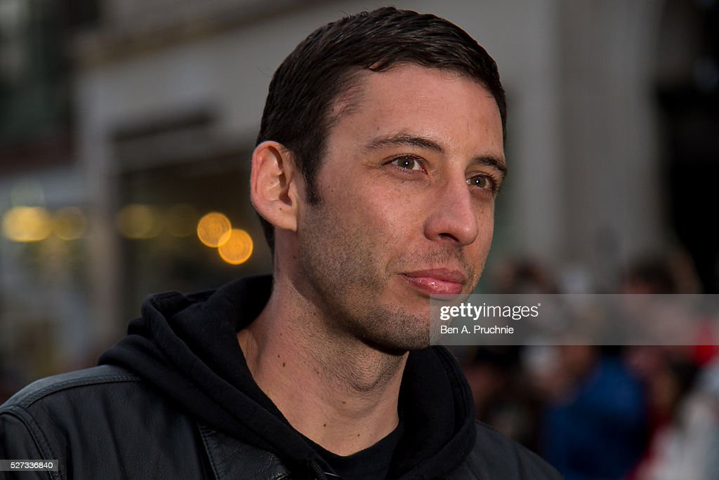 Example aka Elliot John Gleave poses for photographers as Gumball Rally closes down Regent Street at Regent Street on May 3, 2016 in London, England.