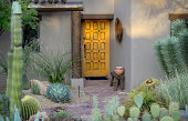 Example of desert Southwest Adobe outdoor architecture and landscaping