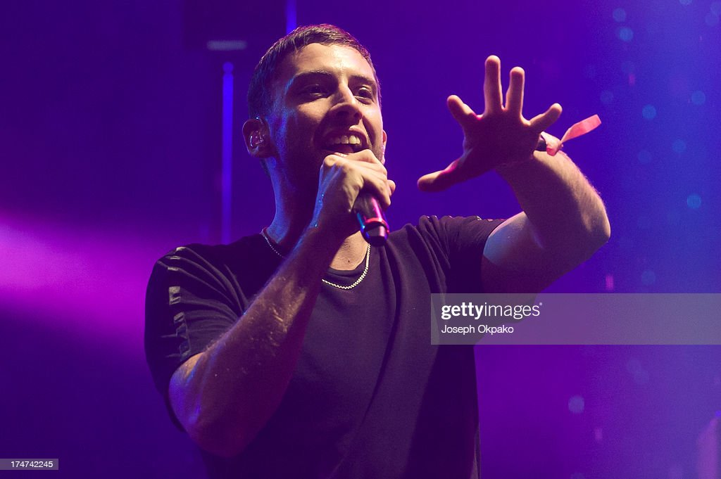 Example performs at Day 2 of Global Gathering at Long Marston Airfield on July 27, 2013 in Stratford-upon-Avon, England.