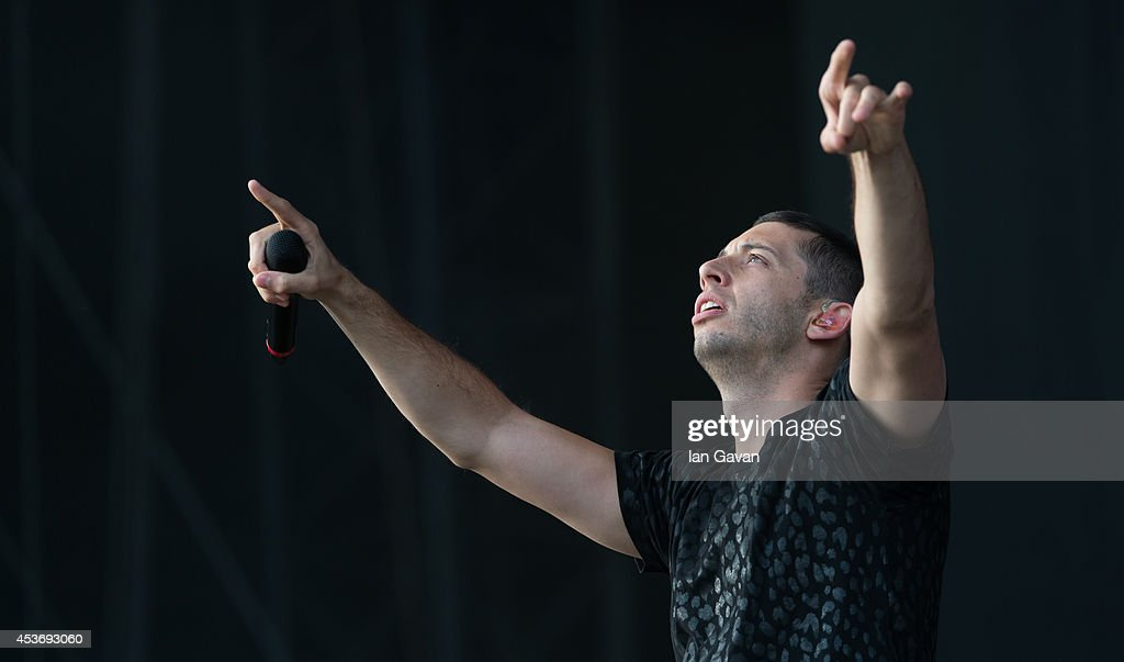 Example performs on Day 1 of the V Festival at Hylands Park on August 16, 2014 in Chelmsford, England.