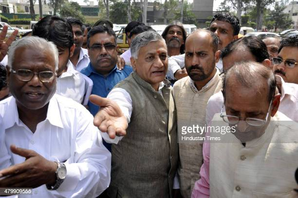 ExArmy Chief and BJP candidate from Ghaziabad VK Singh arrives for filing nomination paper at the Collectorate office on March 21 2014 in Ghaziabad...