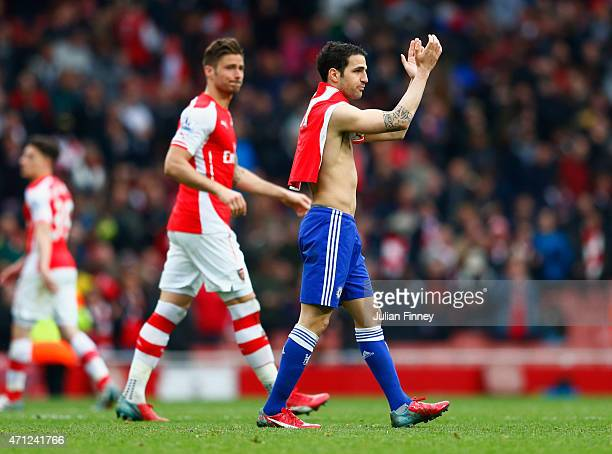 ExArsenal player Cesc Fabregas of Chelsea applauds the crowd after during the Barclays Premier League match between Arsenal and Chelsea at Emirates...