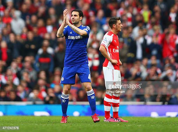 ExArsenal player Cesc Fabregas of Chelsea applauds the crowd as he is substituted during the Barclays Premier League match between Arsenal and...