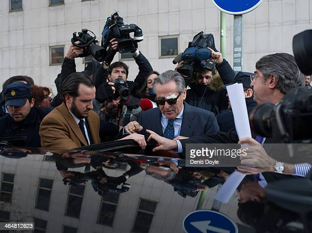 ExBankia president Miguel Blesa gets into a waiting car after giving evidence at a Madrid courthouse relating to the collapse of the Spanish bank...