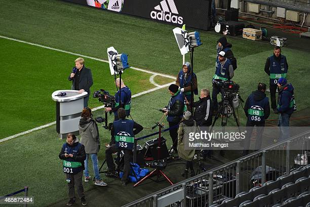 ExBayern Munich goalkeeper Oliver Kahn speaks during a TV broadcast prior to the UEFA Champions League Round of 16 second leg match between FC Bayern...