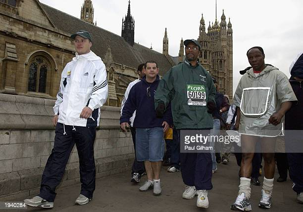 ExBoxer Michael Watson and Chris Eubank walking the last mile of the Flora London Marathon on April 19 in London Michael Watson walked the distance...