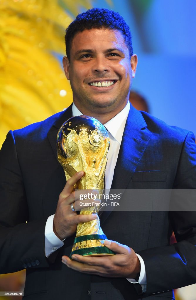 Ex-Brazil international footballer Ronaldo holds the FIFA World Cup Trophy during the Opening Ceremony of the 64th FIFA Congress at the Transamerica Expo Center on June 10, 2014 in Sao Paulo, Brazil.