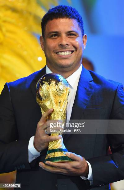 ExBrazil international footballer Ronaldo holds the FIFA World Cup Trophy during the Opening Ceremony of the 64th FIFA Congress at the Transamerica...