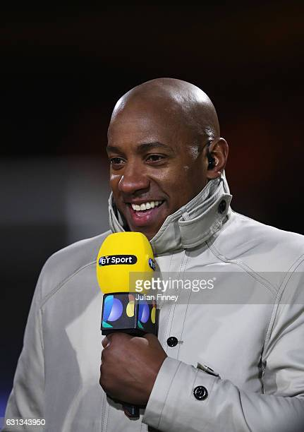 ExCambridge United player and pundit Dion Dublin speaks prior to the Emirates FA Cup Third Round match between Cambridge United and Leeds United at...