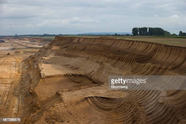 Excavated surface terrain sits at an open pit lignite mine also known as brown coal operated by RWE AG in Hambach Germany on Monday 7 Sept 2015...
