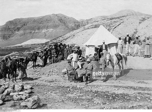 the head of the excavation the German scholar Ernst Sellin and local people 1907 Photo FranzOttoKoch