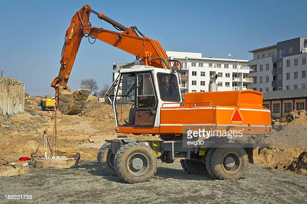 Excavator in a new road construction