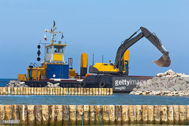 Excavator in a pier construction site