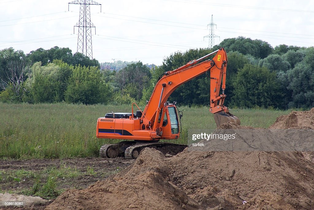 excavator in the field : Stock Photo
