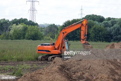 excavator in the field : Stock Photo