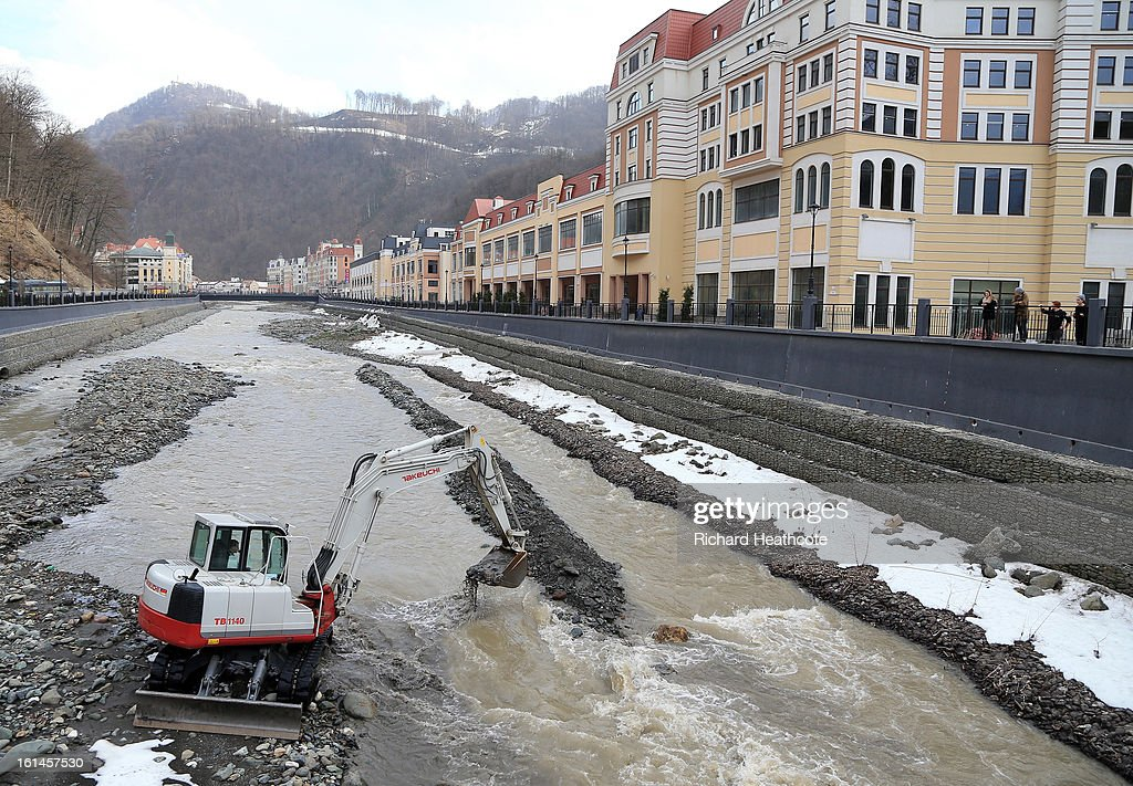A excavator reshapes the river bed in the valley at the Rosa Khutor Alpine Ski Resort on February 11, 2013 in Sochi, Russia. Sochi is preparing for the 2014 Winter Olympics with test events across the venues.