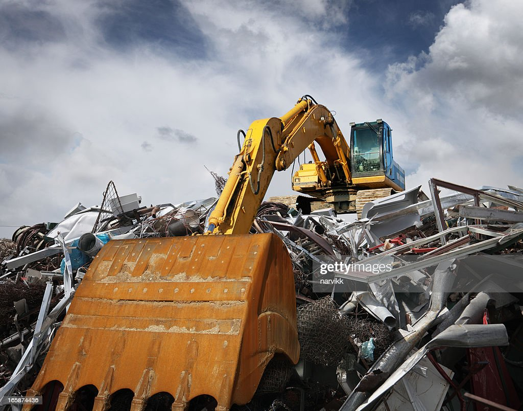 Excavator working at garbage dump : Stock Photo