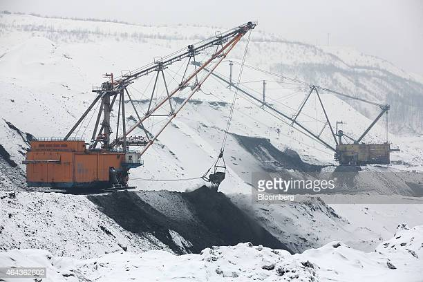 Excavators arrange waste material from coal excavations at the Krasnogorsky open pit coal mine operated by OAO Mechel Mining a unit of OAO Mechel...