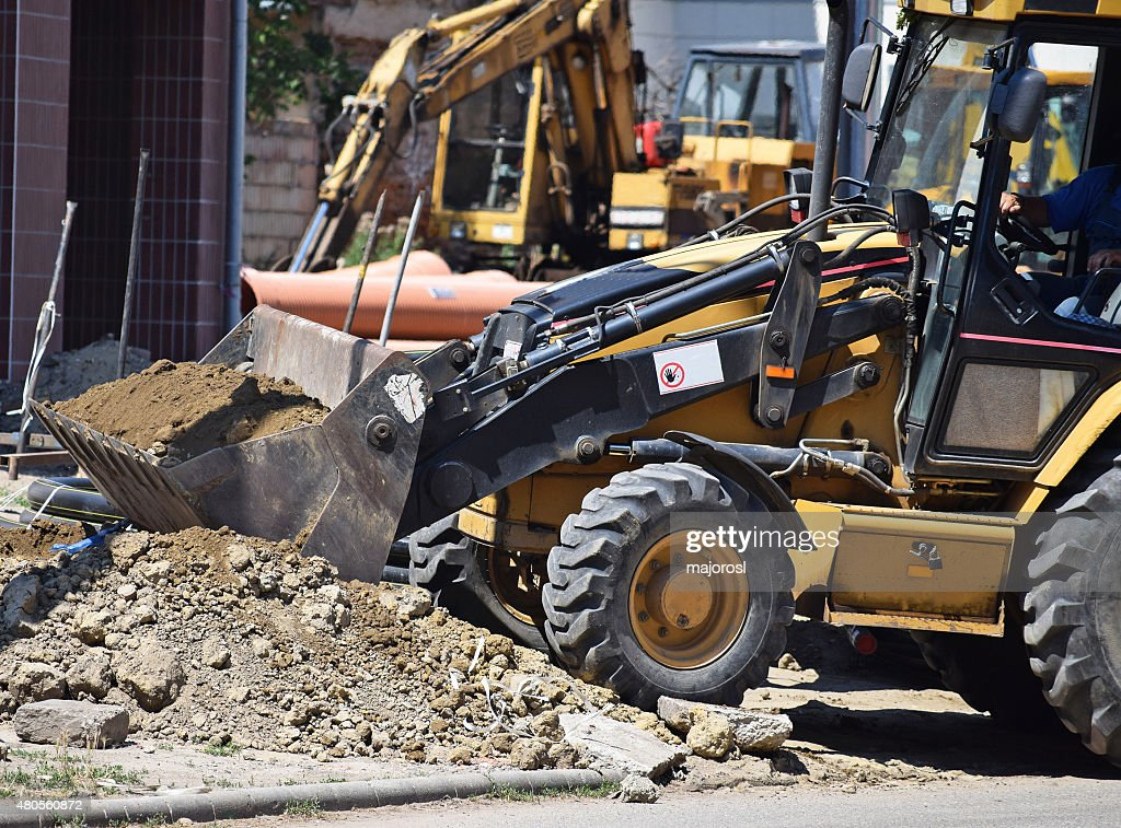 Excavators at the road construction : Stock Photo