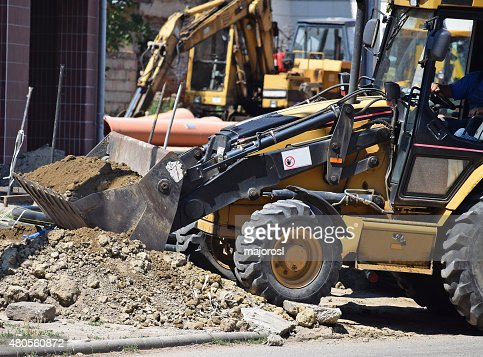 Excavators at the road construction : Stock Photo