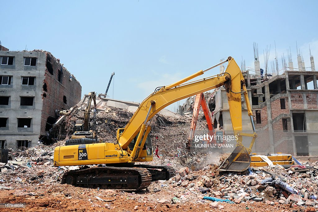 Excavators clear debris at the scene as rescue and army personnel continue recovery operations after the eight-storey building collapsed in Savar, on the outskirts of Dhaka, on May 3, 2013. The death toll from last week's collapse of a garment factory complex in Bangladesh passed 500 as the country's prime minister said Western retailers had to share some of the blame for the tragedy. AFP PHOTO/Munir uz ZAMAN