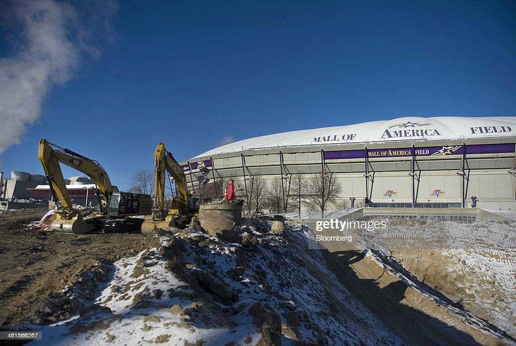 Excavators sit in front of the Hubert H. Humphery Metrodome during its demolition in Minneapolis, Minnesota, U.S., on Tuesday, Jan. 7, 2014. The new stadium is expected to generate development in downtown Minneapolis and provide a venue for national events such as the Super Bowl, said Michele Kelm-Helgen, chair of the Minnesota Sports Facilities Authority, which is overseeing the project at the site of the existing Metrodome. Photographer: Matthew Hintz/Bloomberg via Getty Images